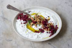 Mast-o-Khiar Yogurt Dip - The prettiest dip in my repertoire - my take on the Iranian preparation of Mast-o-Khiar (yogurt and cucumber). I use lots of fresh herbs, dried rose petals, toasted walnuts and a pop of added color and tartness from dried cranberries.   - from 101Cookbooks.com
