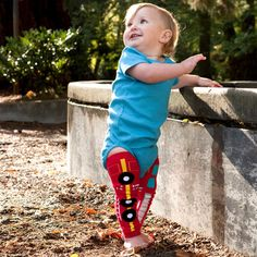 Baby boy wearing BabyLegs Fire Engine legwarmers