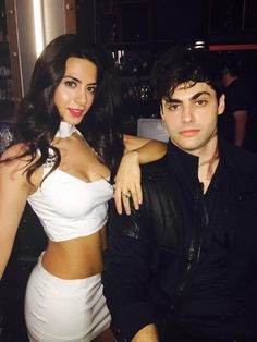 Isabelle (Emeraude Toubia) and Alec LIghtwood (Matthew Daddario) prepare to hunt demons in SHADOWHUNTERS