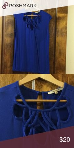 cce17197c3ad8 Blue knit cut out sleeveless shirt Soft knit shirt with unique cut out  pattern. 41