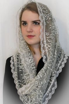 Gathered at seam for added detail at bottom. Wear as scarf, and simply slip up to cover head. Ivory with black accents floralsoft stretch lace. Trimmed in lace on both sides. This is a quality fabric.