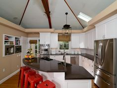 Pictures of Colorful Kitchens: Ideas for Using Color in the Kitchen   Kitchen Ideas & Design with Cabinets, Islands, Backsplashes   HGTV - red chairs by the rounded breakfast bar