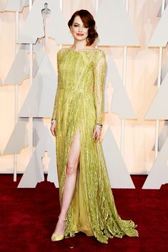 Emma Stone arrives in Elie Saab Couture to the 2015 Oscars red carpet.