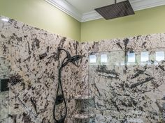 Project by East Coast Granite & Marble in Columbia, SC.    This stone is a Delicatus White Granite.    Visit us at www.eastcoastgranitecolumbia.com to see more of our work.     #granitecountertops #countertops #bathroomcountertops #bathroomdesign #bathroomremodel #bathroomvanities #columbiacountertops #DelicatusWhite #DelicatusWhiteGraniteBathrooCountertops #granite #showerseat #showershelf