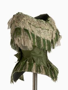 This green silk bodice, ca. is an example of some that are in my novel--an innovation that allowed women to remove the bodice but stay in the skirt. Different bodices were used for tea, dinner and the opera, so as to allow a woman to change more quickly. 1850s Fashion, Victorian Fashion, Vintage Fashion, Historical Costume, Historical Clothing, Green Gown, Green Silk, Vintage Dresses, Vintage Outfits