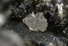 Penkvilksite, Na4Ti2Si8O22 · 4H2O,  Mont Saint Hilaire, Québec, Canada. Translucent colourless cluster