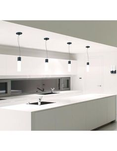 Nuvo Lighting's Link Collection lends an artistic touch to the clean lines of this minimalist kitchen. www.nuvolighting.com