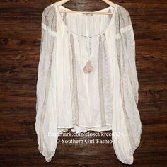 """MES DEMOISELLES PARIS Blouse Embroidered Peasant One Size Fits All.  Perfect Condition. $376 Retail + Tax.   Stunning crinkled ivory peasant blouse with over-sized silhouette.  Contrast embroidery and pleated neckline.  Gathered elastic banding at cuffs. Nude/ivory.  Unlined.   ❗️ Please - no trades, PP, holds, or Modeling.   ✔️ Reasonable offers considered when submitted using the blue """"offer"""" button.    Bundle 2+ items for a 20% discount!    Stop by my closet for even more items from this…"""