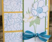 Bold flower card with blue, yellow and green