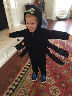 "Easy homemade spider costume! Cut black tights, stuff with filling and attach to black hoody. Connect ""legs"" with white yarn ""webbing"" and add eyes."