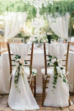 Beautiful chiffon draped chairs for the bride, and groom.