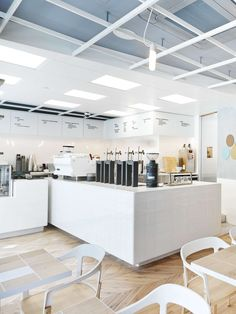 Love this laboratory-inspired coffee bar and how they utilize a minimalist menu wrapped on the wall and simple square white tiles.