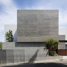 House in Shinoharadai, Japan, by Tai and Associates has some concrete walls formed against wooden planks, some rendered white and others left plain.
