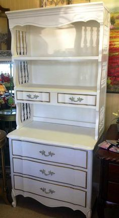 French provincial chest with attached bookshelf.