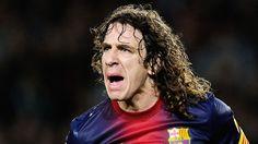 Carragher loves it as Barca legend Puyol hacks down United hero Neville