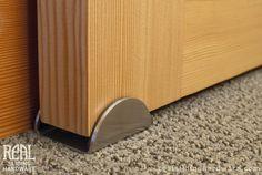 Real Sliding Hardware - C-Guide, $38.00 (http://www.realslidinghardware.com/c-bottom-guide-for-barn-door-hardware/)