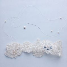 The final and my favorite step, embellishment! Lovely hand stitched freshwater pearls. #mamieandjames #weddinggarter