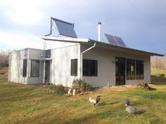 Enjoying Energy Efficient Off Grid Modern Prefab SIP Home Passive Solar Design And Muddy Concrete Floors
