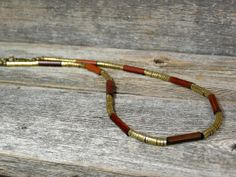 """Brass Necklace  Heishi Necklace by StoneWearDesigns, Brass heishi and bamboo wood tube beads are beaded together, heishi beads are 4mm and bamboo tube beads are the same in diameter x 3/4"""" long. Finished off with a brass lobster claw clasp and three cable links for adjustable length. Length: 18 1/4"""" to 19""""."""
