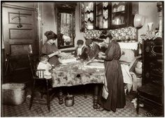 December 1911. Family of Mrs. Mette making flowers in a very dirty tenement, 302 Mott Street, top floor. Josephine, 13, helps outside school hours until 9 P.M. sometimes. She is soon to be 14 and expects to go to work in an embroidery factory. Says she worked in that factory all last summer. Nicholas, 6 years old and Johnnie, 8 yrs. The old work some. All together earn only 40 to 50 cents a day. Baby (20 months old) plays with the flowers, and they expect he can help a little before long.