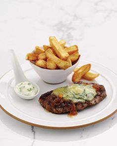 This easy recipe for sirloin steaks is served with caramelised onions and a garlic and tarragon sauce.