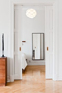 Good design tip - use of a mirror as you walk into a space.  Excellent at the bottom of the stairs if you walk into a wall.