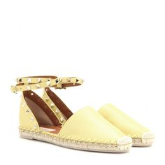 Valentino - Rockstud Double leather espadrille sandals - A summer essential, the espadrille gets the Valentino treatment, which is nothing short of luxurious. The breathable, grainy pastel-yellow leather is a practical option for hotter weather, with signature pyramid studs adding the final touch. seen @ www.mytheresa.com