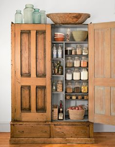 To convert this armoire into a kitchen pantry, the owner of this Minneapolis loft added extra shelves and magnetic door closures. - CountryLiving.com