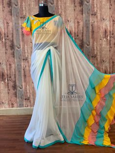 Available Stylish multi colour ruffled Pallu on a Half white Georgette saree teamed with a yellow hand work blouse from Team… Fancy Blouse Designs, Sari Blouse Designs, Saree Blouse Patterns, Designer Blouse Patterns, Pattern Blouses For Sarees, Dress Designs, Hyderabad, Hand Work Blouse, Checks Saree
