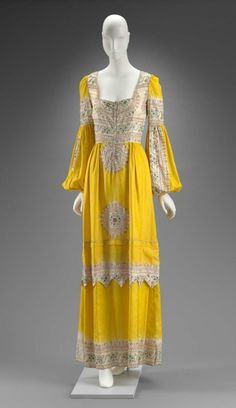 "Dress of yellow silk imported from Rajasthan, India, resist died (tie-dyed) and embroidered with silk and metallic yarns in Indian-inspired motifs in Italy for / ""Thea Porter / London / Made in England c. 1970"