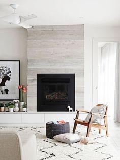 Off centered fireplace. whitewashed fireplace. Modern fireplace in living room off centered from space.