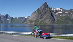 lofoten islands norway  ( What a shot... except for the unnatural colors on the bicycle ;-)