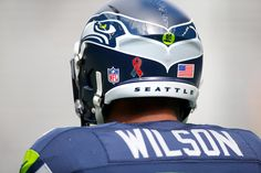 Russell Wilson Photos Photos - Quarterback Russell Wilson #3 of the Seattle Seahawks is seen warming up before an NFL game against the Miami Dolphins at CenturyLink Field on September 11, 2016 in Seattle, Washington. - Miami Dolphins v Seattle Seahawks