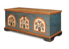 """Sold For $13,000                                                          Pennsylvania painted pine dower chest, late 18th c., attributed to Johann Rank, the front decorated with three potted tulip panels on a blue ground supported by bracket feet, 22'' h., 49 1/2'' w.                            Condition report           20"""" d. Overall good condition"""