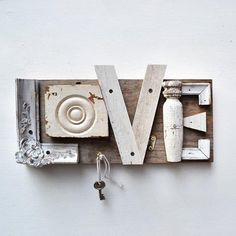 Salvaged house & picture frame trim used to create this cute sign.