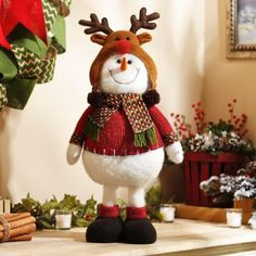 This charming plush snowman will melt your heart! Dressed in a red sweater and cozy reindeer hat, this snowman statue is a frosty addition to your holiday home. Christmas Animals, Christmas Snowman, All Things Christmas, Christmas Time, Christmas Crafts, Christmas Ornaments, Christmas Stockings, Handmade Christmas Decorations, Xmas Decorations