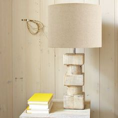 The solid-wood Totem Table Lamp's sculptural form is softened by a light finish with a hand-hewn feel. One of our larger lamps, its size and scale works well next to larger couches and beds.         • Mango wood base with whitewashed finish.