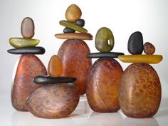 Melanie Guernsey Leppla and her Glass Sculptural Cairns (stones). Choose one or more to create an ensemble. Shown in tortoise shell amber colors, 3 to 6 pieces per Cairn. Rock Sculpture, Muse Art, Glass Ceramic, Pebble Art, Glass Design, Stone Art, Fused Glass, Blown Glass, Rock Art