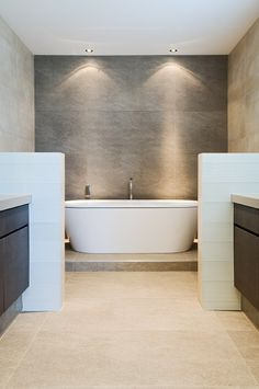 I like the separation of the tub from the rest of the bathroom. I would raise & sink it with steps up to it.