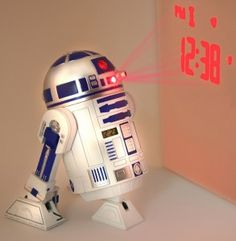 this awesome r2d2 alarm clock will bleep, tweet,burp, and twitter you but also it will project the time, date and seconds onto your ceiling or wall when the alarm goes off for $28.69  http://darthvaderstore.com/star-wars-r2d2-alarm-clock   #star wars #r2d2 #gadgets #alarmclock