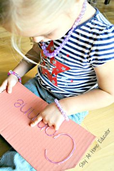 Hot glue name plates provide a tactile way for preschoolers to learn name…