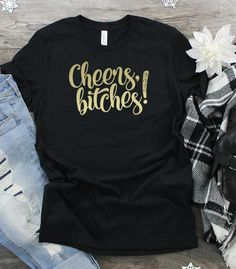 Cheers Bitches its Ring in the new year in comfort and style in one of our Bella Canvas unisex tees. New Years Eve Shirt, New Years Shirts, New Years Outfit, New Years Eve Outfits, Cheer Shirts, Vinyl Shirts, Custom Shirts, New Year's Eve 2020, Crew Shirt