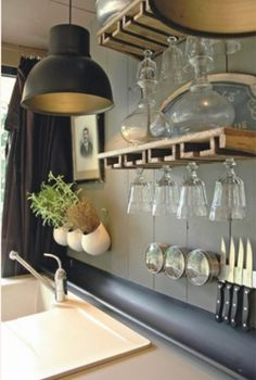 Love this kitchen. Ikea's HEKTAR pendant light above the sink.