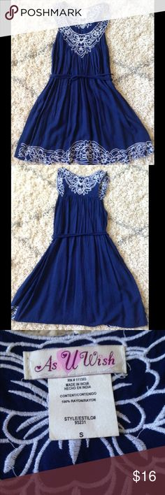 As U Wish Blue Dress This dress is beautiful! It is flowing and gorgeous! There are two strings on the sides which help accentuate your waist! The white details are amazon in person! It has plenty of life left in it and comes from a smoke free home! As U Wish Dresses