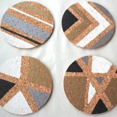 DIY Cork Coasters {Coasters}These coasters are perfectly chic and great for entertaining! Plus with the great tutorial found in this post you can make a set for your home! All you'll need is plain cork coasters and some acrylic paint. Easy to create and inexpensive to make!View This Tutorial
