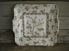 reserved for native Antique Ironstone Plate Brown Transferware Birds and Dogwood. $10.00, via Etsy.:art for kitchen