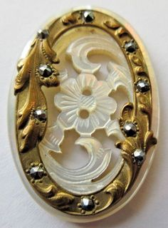 Antique Button…Beautiful Carved & Finely Engraved Iridescent Pearl with Brass & Cut Steels. The open brass column is raised giving the button nice depth. Sewing Machine Accessories, Vintage Sewing Machines, Antique Clocks, Linens And Lace, Button Art, Antique Lace, Vintage Buttons, Body Jewelry, Vintage Jewelry