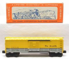 Lionel postwar 6464-650 Rio Grande type IV boxcar with scarce gray body mold painted yellow and silver in OB that has paste on labels for the suffix.  The car has never been run, C9-10.  OB has all flaps attached.