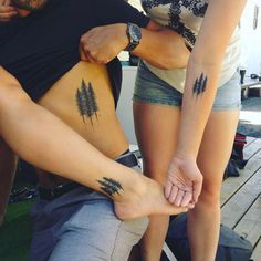 Matching tree tattoos by Chelsea Spencer