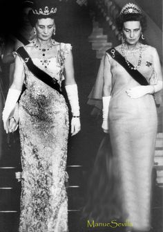 Queen Olga, (an exile by the time this photo was taken) wearing the massive Cartier tiara, along side her sister, Marina, the Duchess of Kent, wearing the Cambridge Sapphire parure, at the wedding in Athens of Sophia of Greece and Juan Carlos of Spain in May 1962.